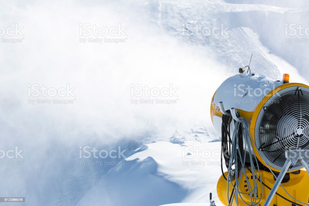 Snow cannon, snowmaker in action at ski resort stock photo