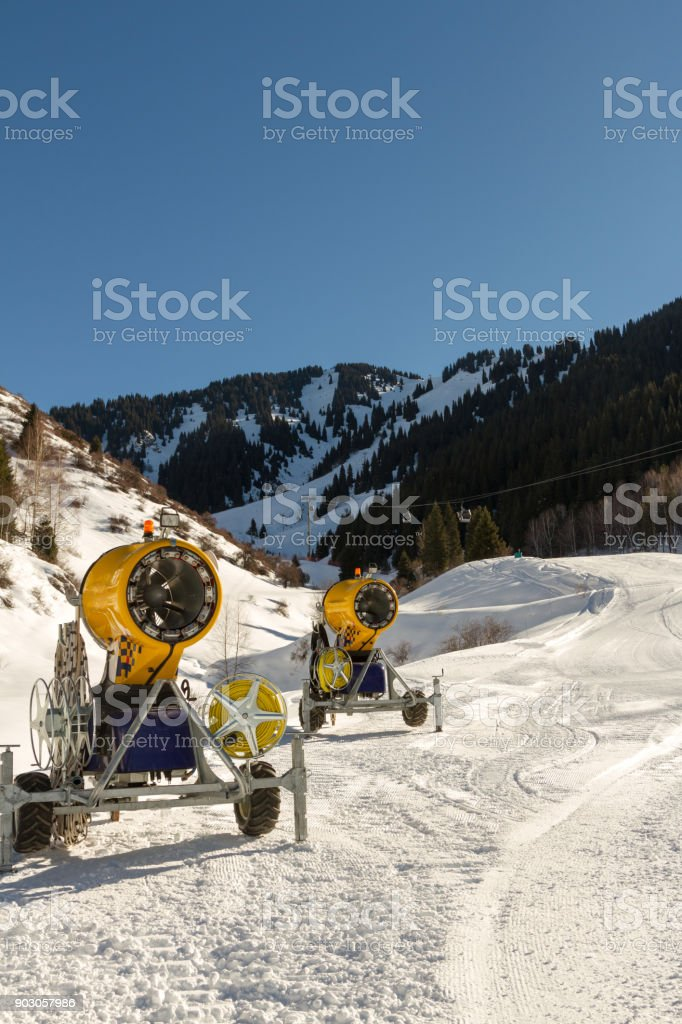 snow cannons along the route to the ski resort stock photo