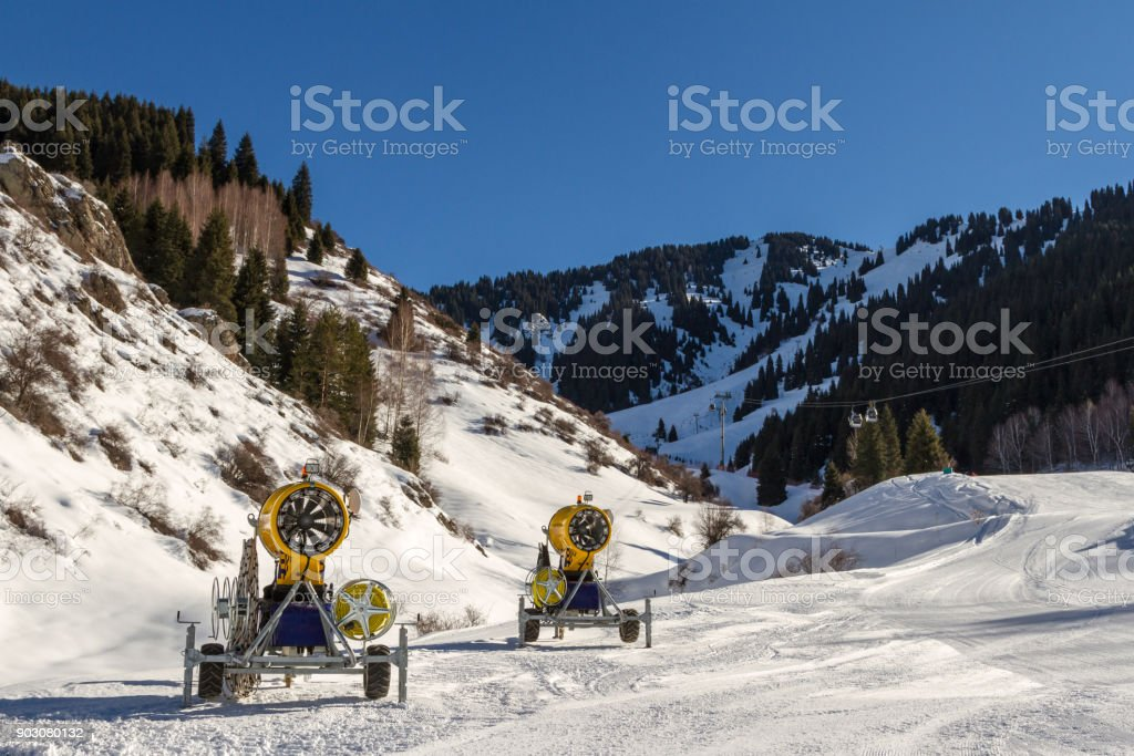 Snow cannons on the mountain stock photo