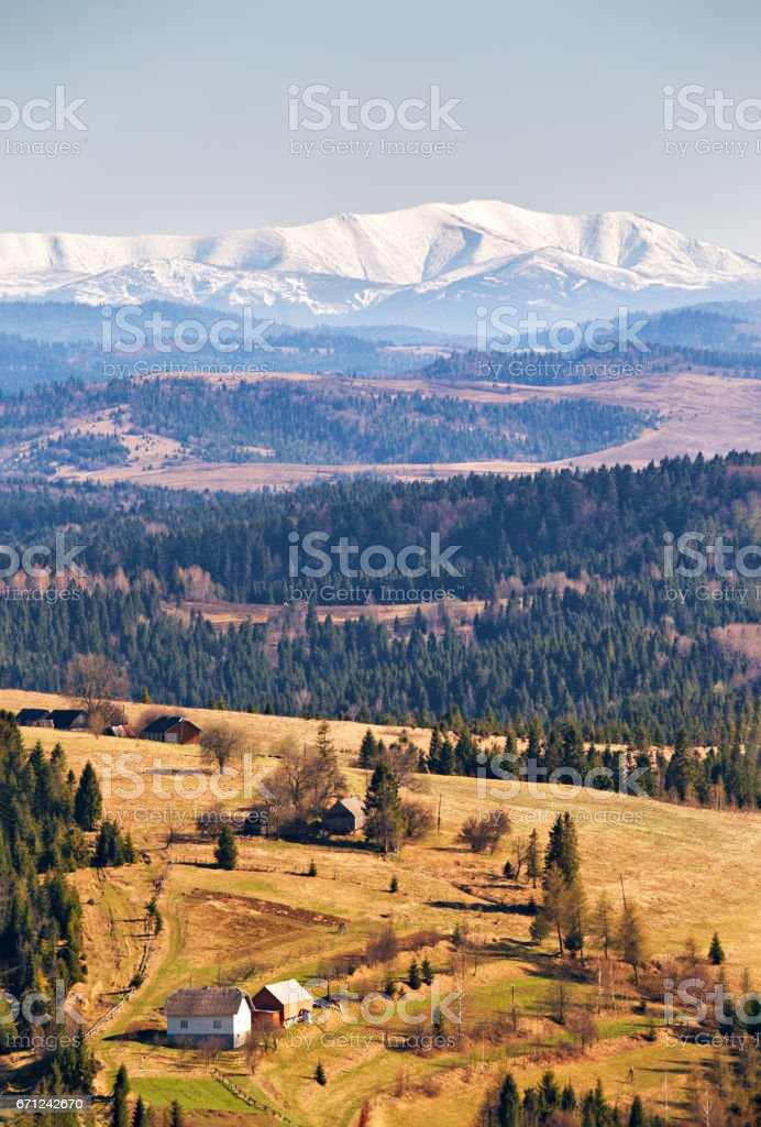 Snow caped mountains in sunny spring day. stock photo