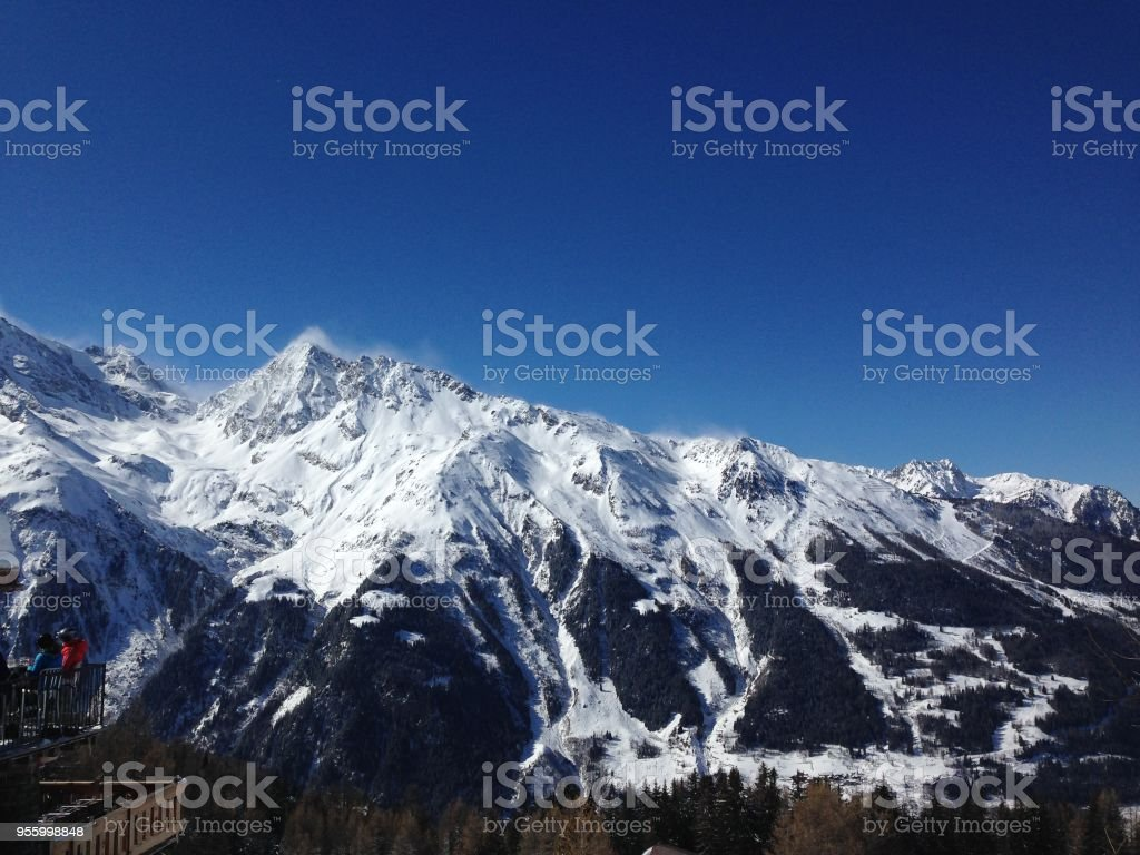 Snow capped mountain views from Sainte Foy, France stock photo