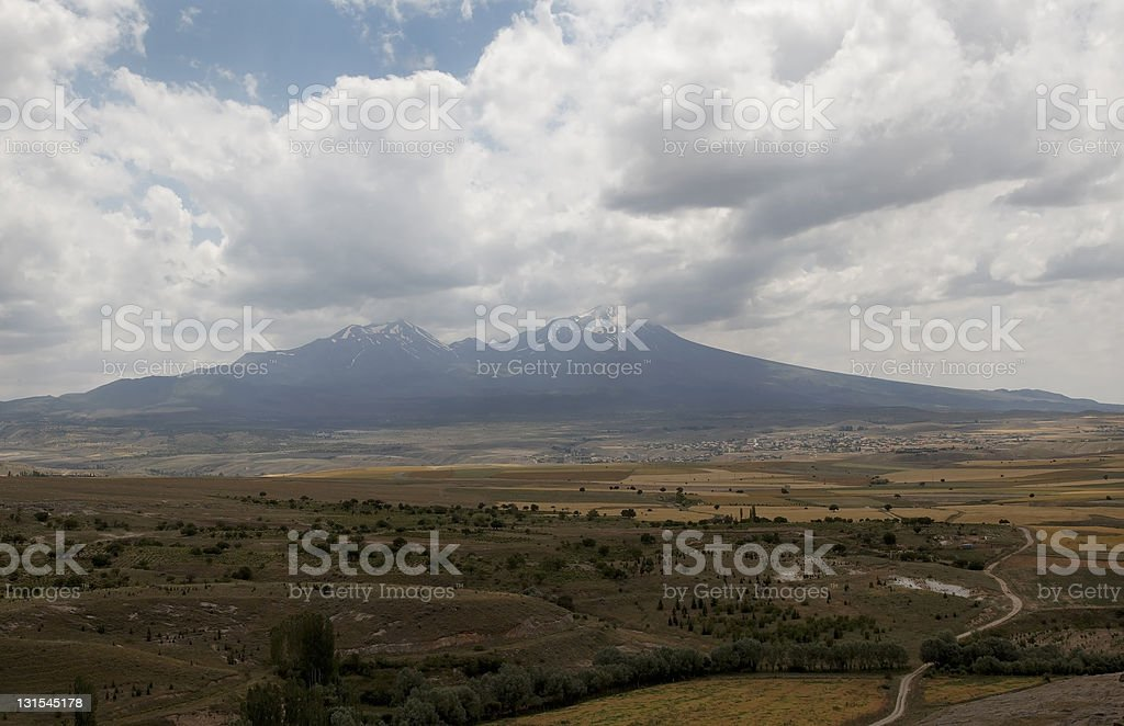 snow capped mountains and plains of Cappadocia stock photo