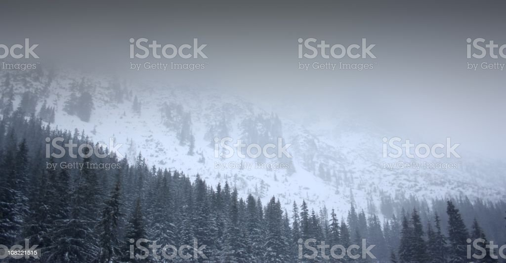 Snow Capped Mountains in the Fog royalty-free stock photo