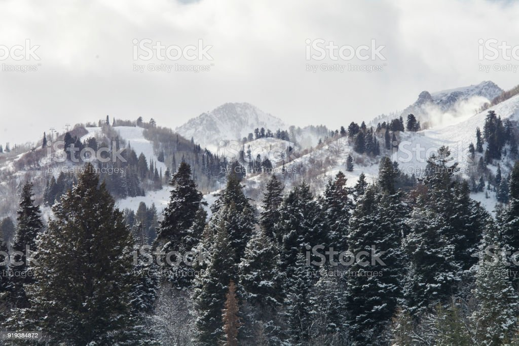snow capped mountains in utah winter winter storm in the mountains of utah Adventure Stock Photo