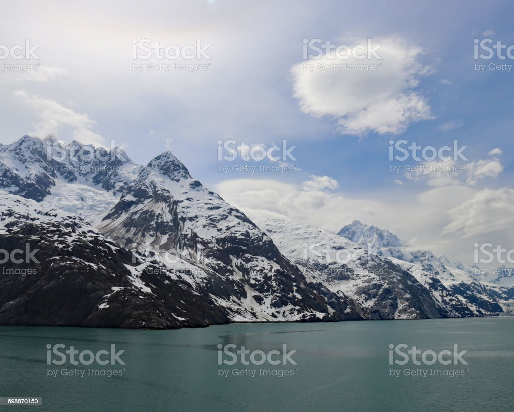 Snow capped mountains of College Fjord Alaska stock photo