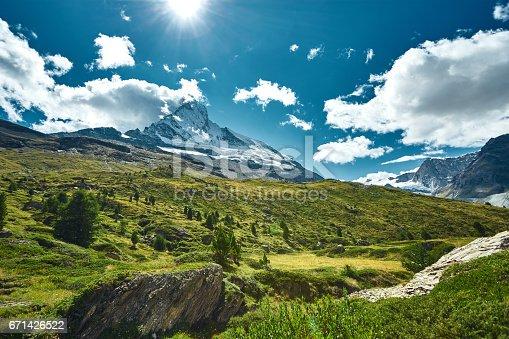 istock Snow capped mountains. View of Matterhorn mount 671426522