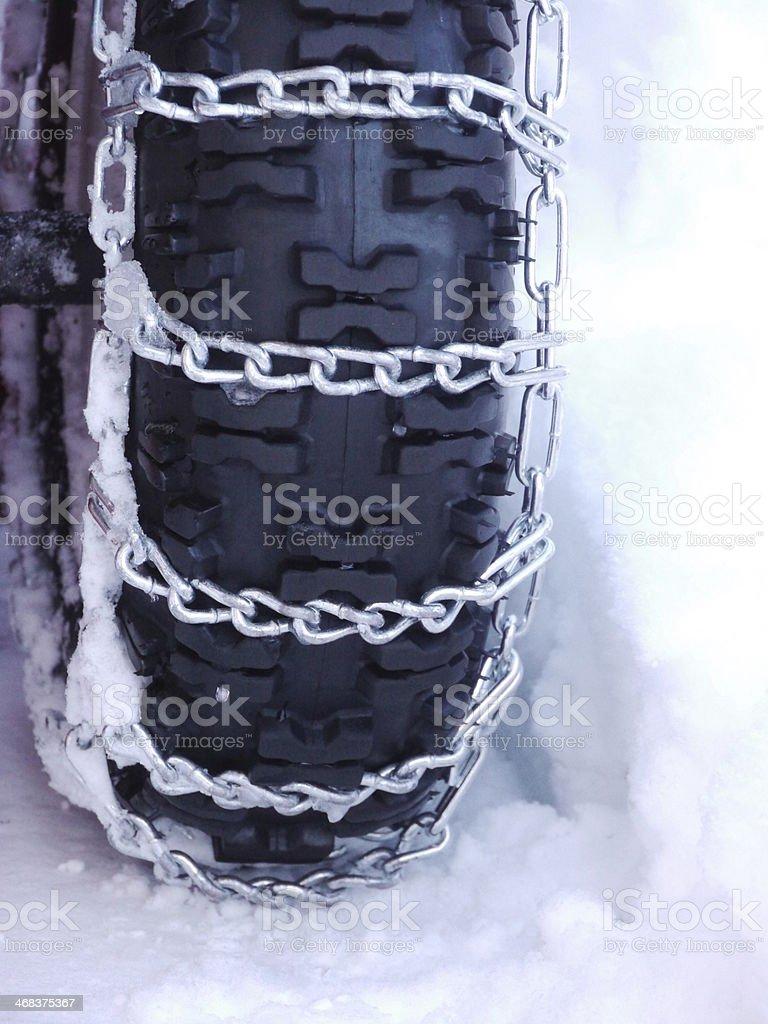Snow chains tyre stock photo
