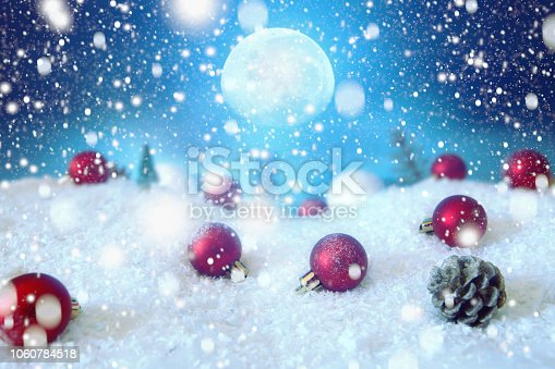 865140324 istock photo Snow christmas magic lights background. Christmas card with a winter forest and christmas decorations in a moonlit night. The elements of this image furnished by NASA 1060784518
