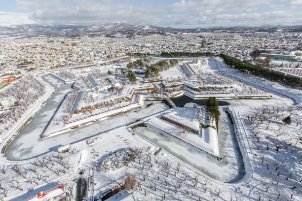 snow cityscape and star construction view from Goryokaku tower in Winter. Hakodate, Hokkaido, Japan stock photo