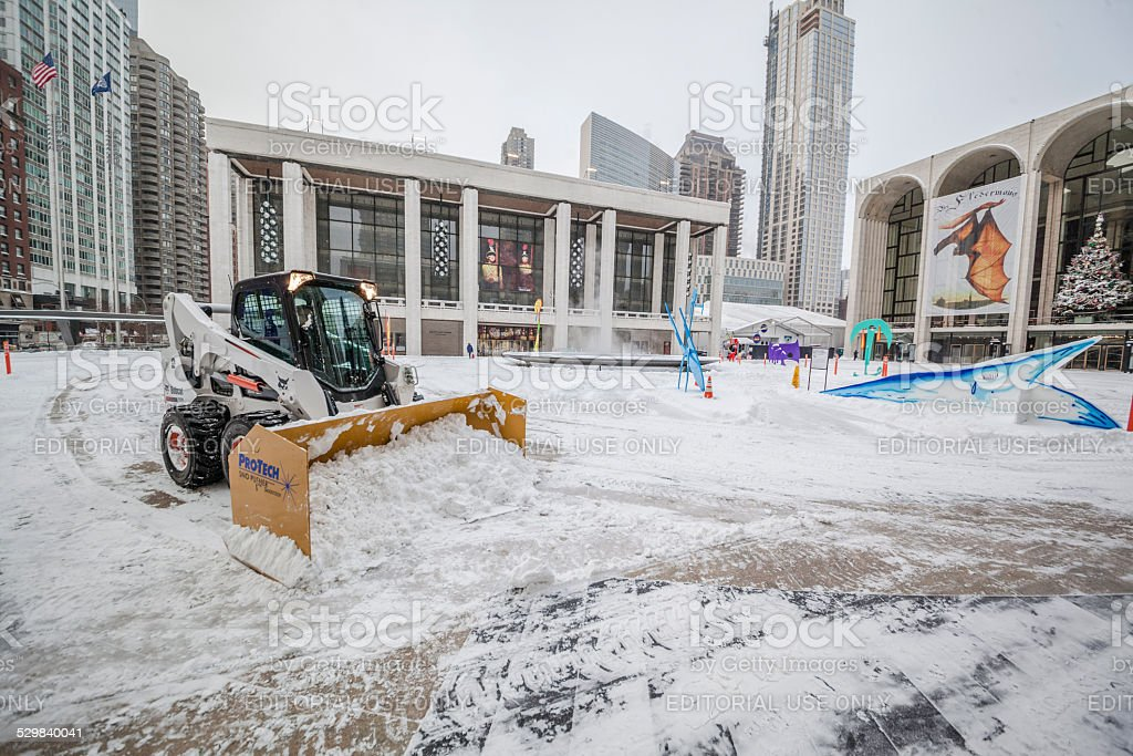 Snow cleaning in Manhattan around the Lincoln Center under snowstorm stock photo
