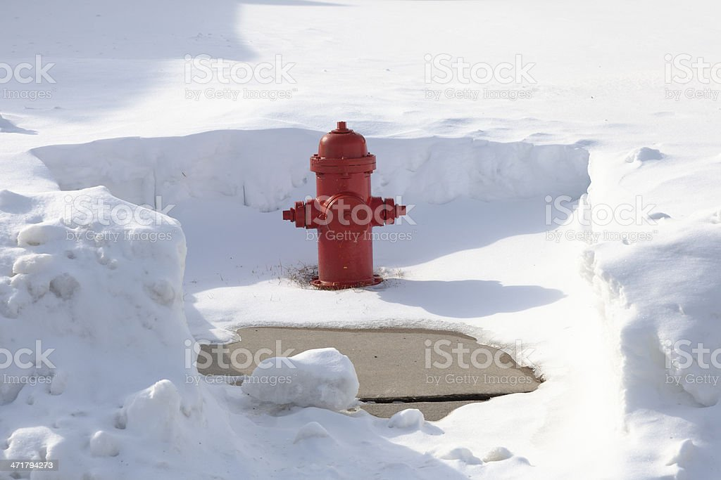 Snow Cleared Red Fire Hydrant stock photo