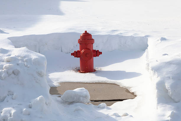 Snow Cleared Red Fire Hydrant Snow cleared red fire hydrant. Community service oriented. Hydrants are cleared after a large snow storm. Vibrant red color against the white and blue and gray of the snow. Good for cropping or copy placement. XXXL size. fire hydrant stock pictures, royalty-free photos & images