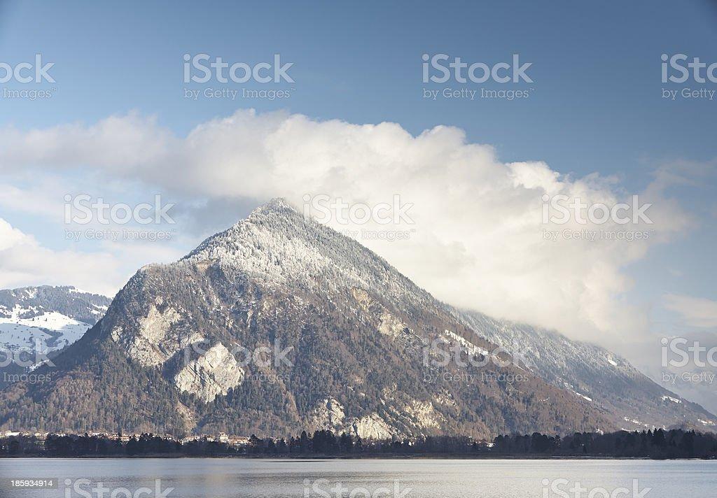 Snow cover mountain near lake from far royalty-free stock photo