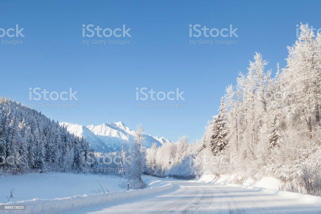 Snow covered Alaskan highway stock photo