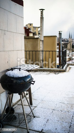 Snow covered barbecue
