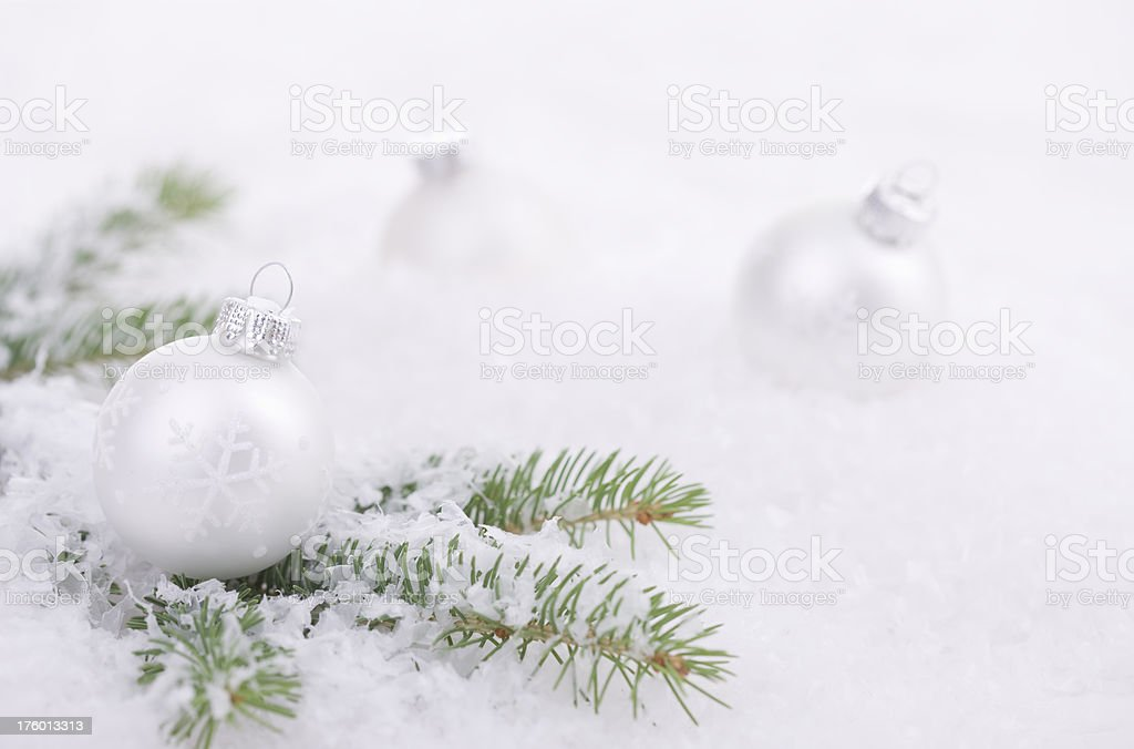 Snow Covered Baubles stock photo