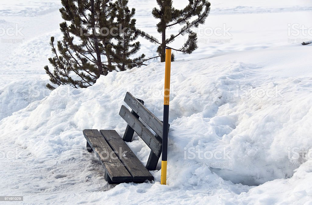 Snow covered bench and pole royalty-free stock photo