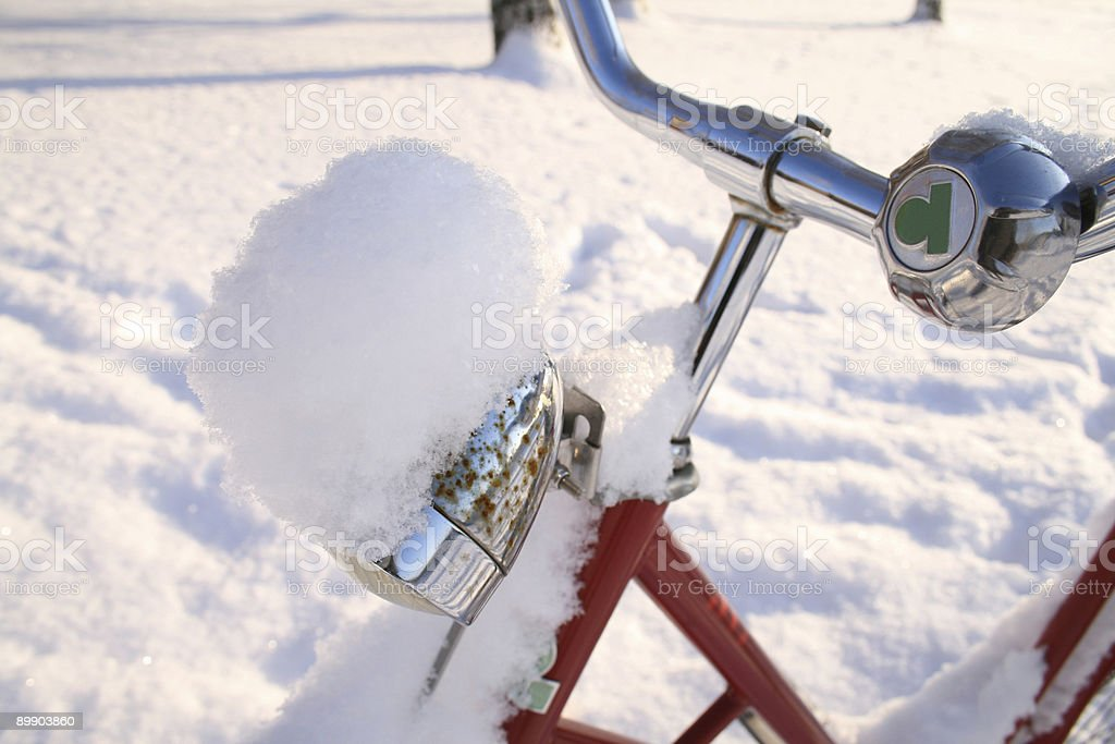 Snow covered bicycle light royalty-free stock photo