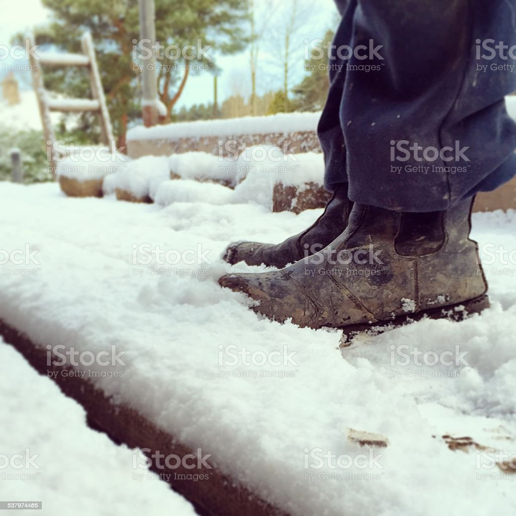 Snow Covered Boots stock photo