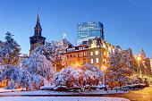 Snow covered Boston Public Garden. The Boston Public Garden, is a large park in the heart of Boston, Massachusetts, adjacent to Boston Common.