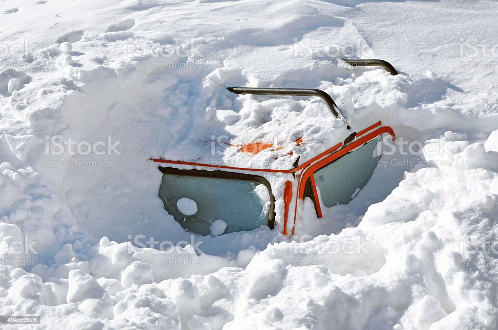 Snow covered car in the winter blizzard stock photo