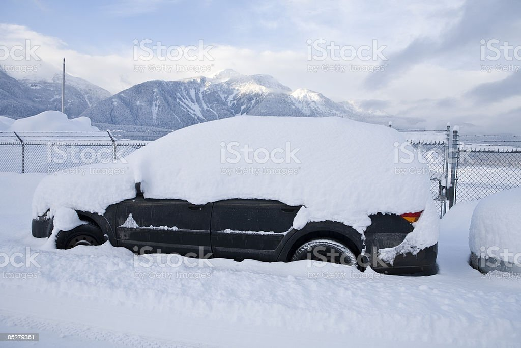 A snow covered car. royalty-free stock photo
