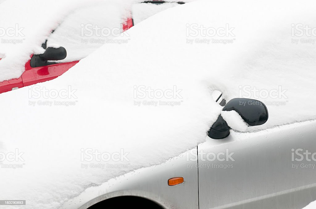 Family cars covered in fresh snow.