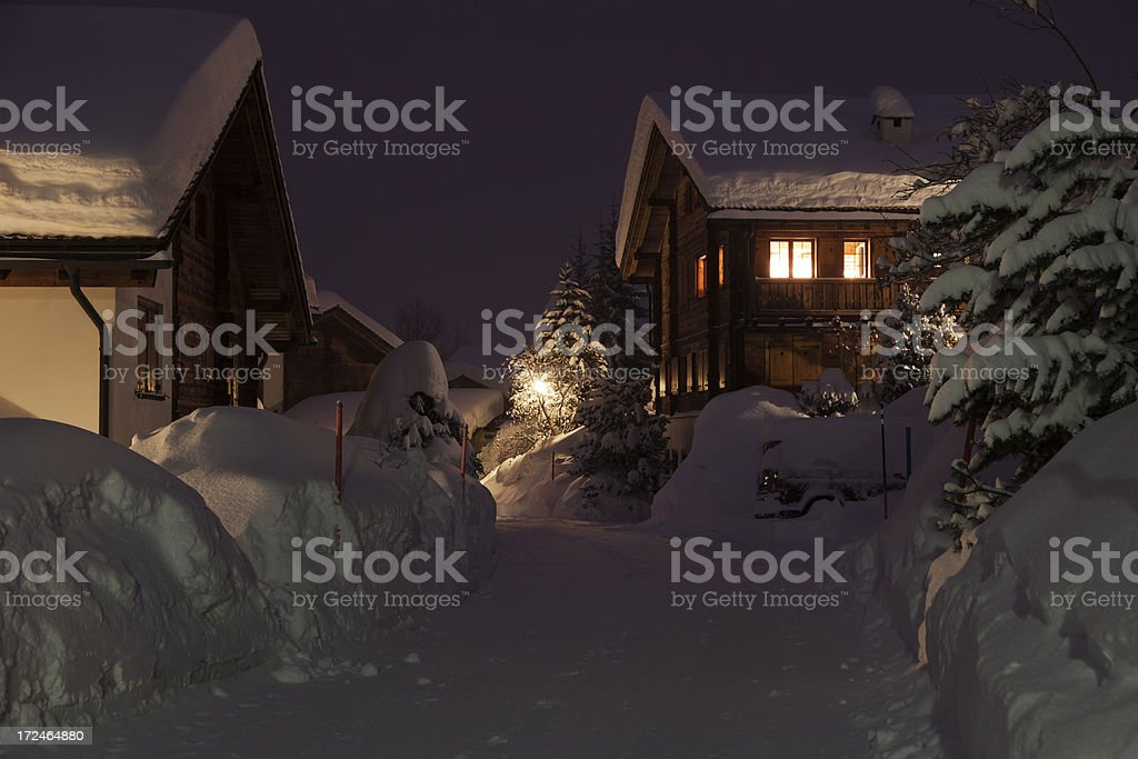 Snow Covered Chalets at Night stock photo