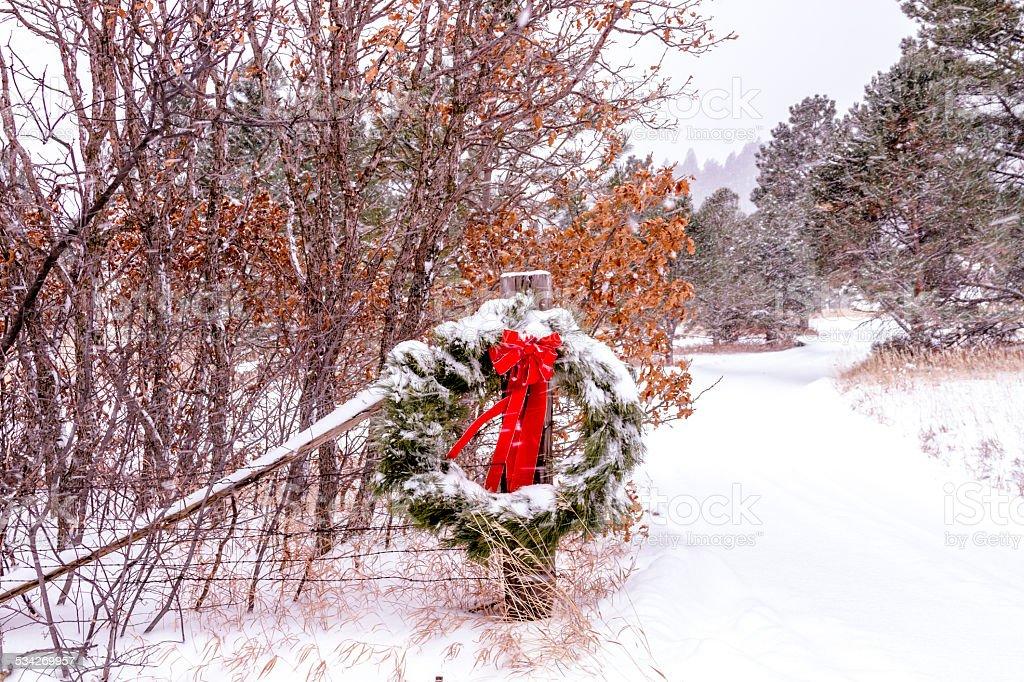 Snow Covered Christmas Wreath stock photo