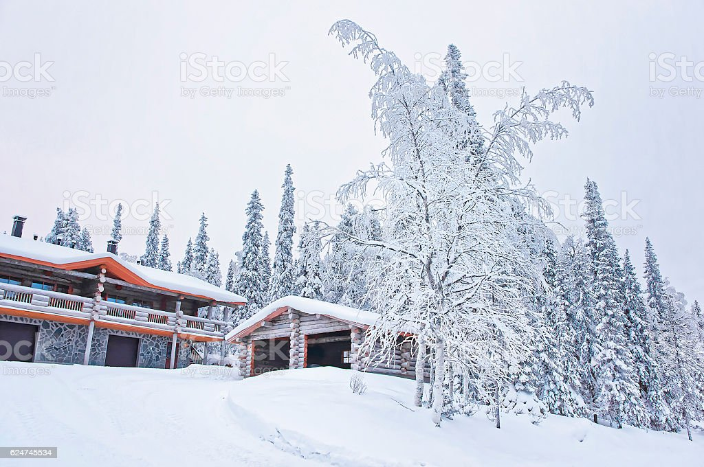 Snow covered Cottages in Ruka in Finland stock photo