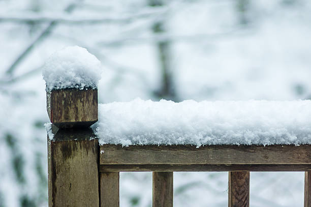 snow covered fence railing in winter - snow pile stock photos and pictures