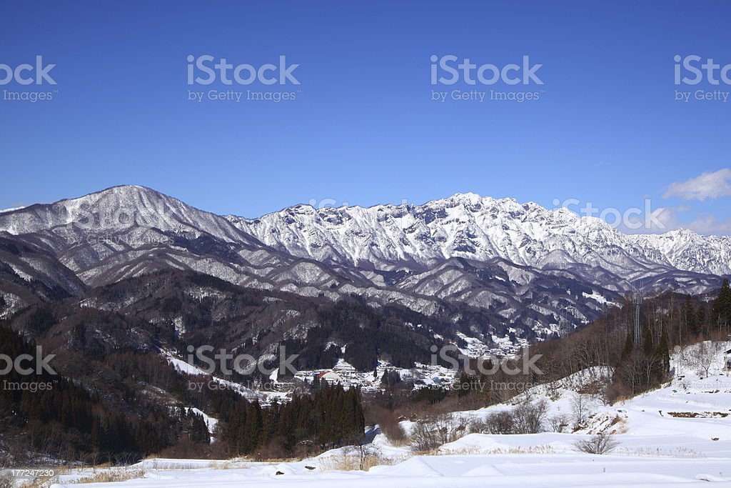 Snow covered field and Mt.Togakushi stock photo