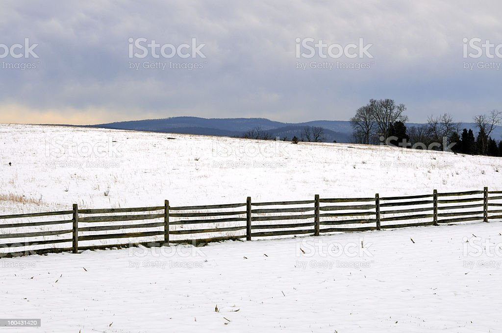 Snow Covered Field with Fence stock photo