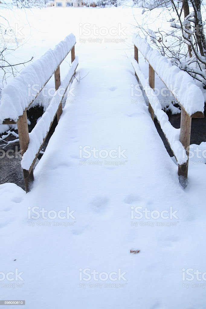 Snow covered footbridge on a foggy winter day royalty-free stock photo