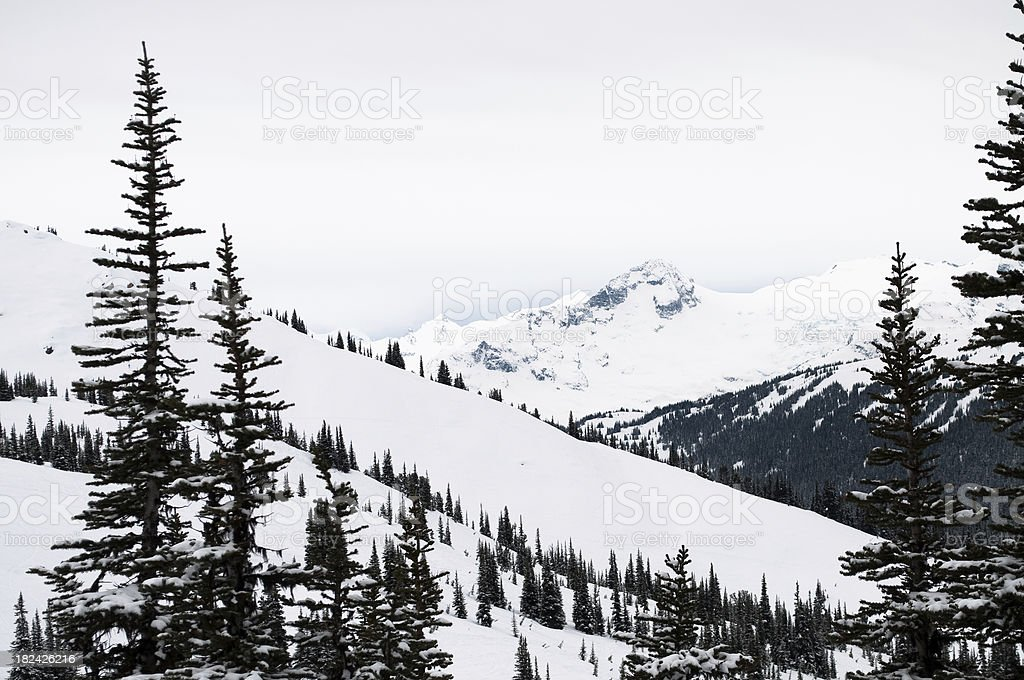 Snow covered hills and mountains stock photo