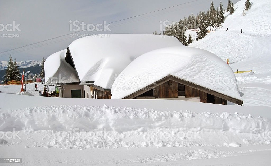 snow covered houses in Wagrain royalty-free stock photo