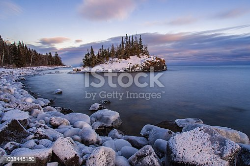 istock Snow covered island on Lake Superior during sunsert 1038445150