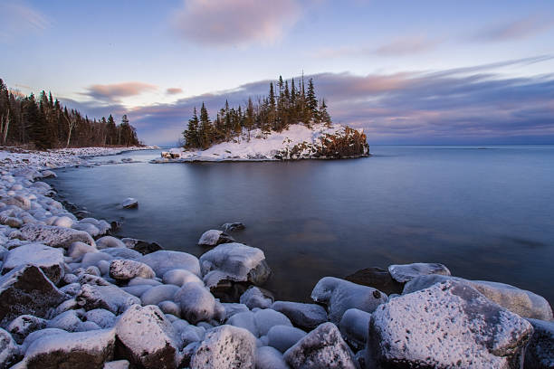 Snow covered island on Lake Superior during sunsert Horseshoe bay island covered by winters snow. minnesota stock pictures, royalty-free photos & images