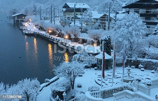 Snow covered lakeside village in Austria
