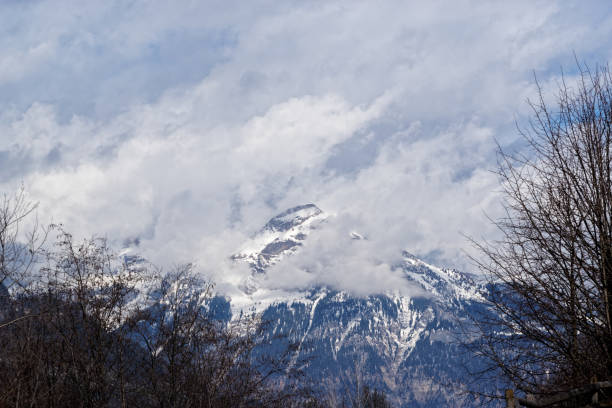 Snow covered mountain peak in clouds, Ziller Valley in Austria stock photo