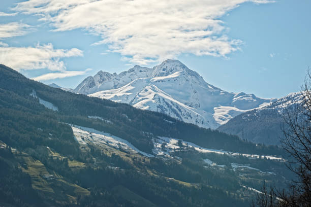 Snow covered mountain peak in Zillertal stock photo