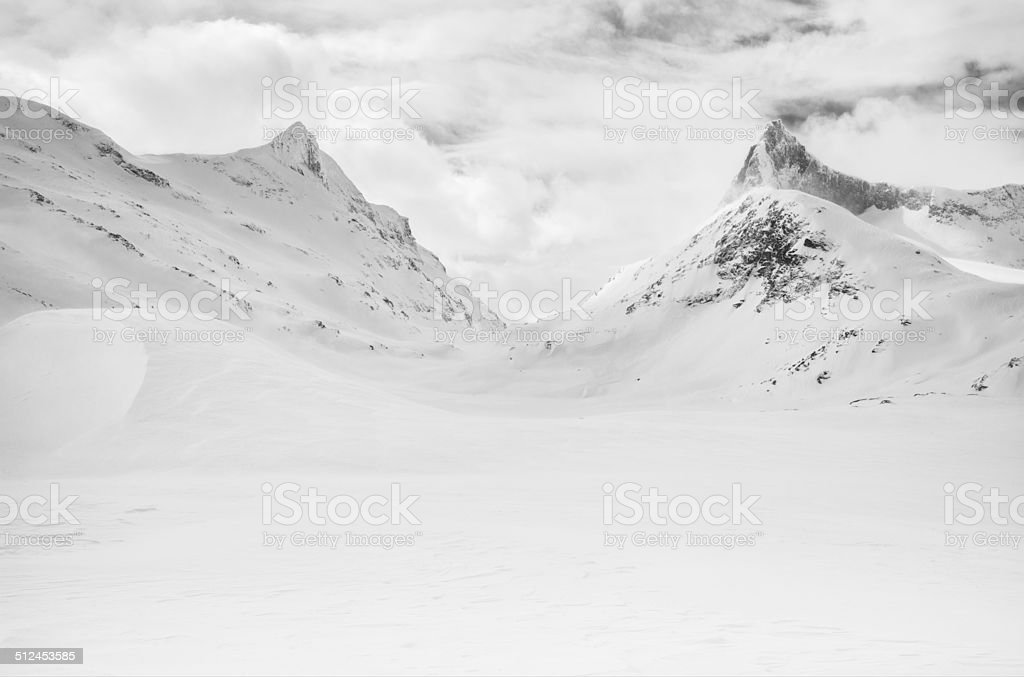 Snow covered mountain peaks in Jotunheimen National Park stock photo
