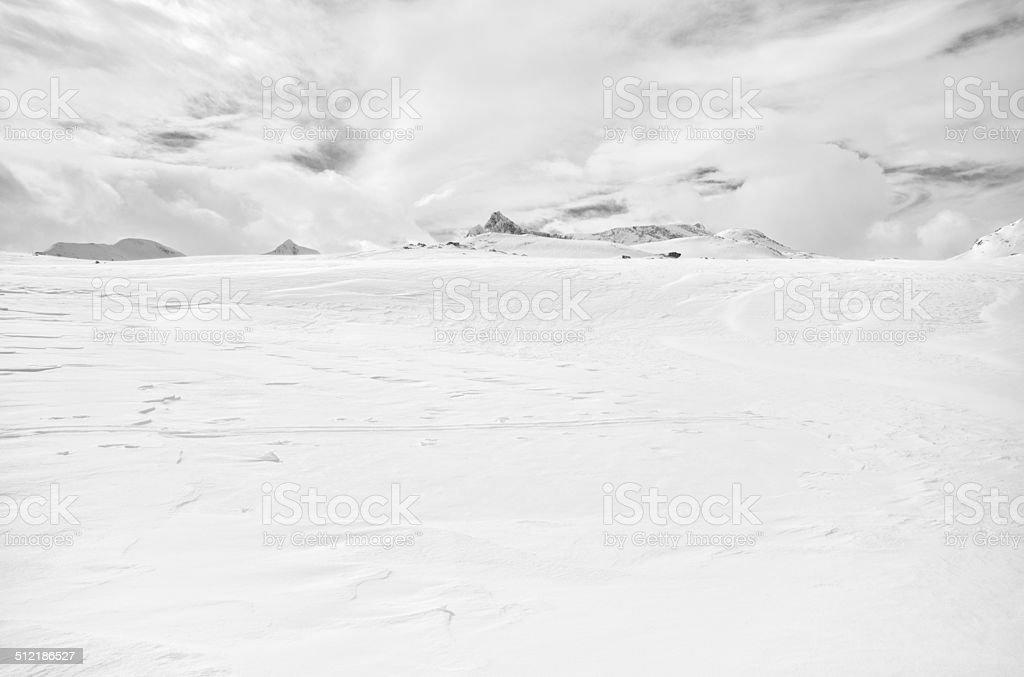 Snow covered mountain plateau and surrounding mountain peaks in Jotunheimen stock photo