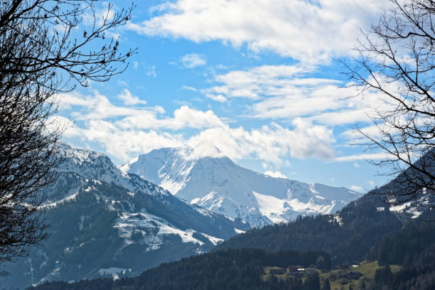 Snow covered mountain range in Zillertal stock photo