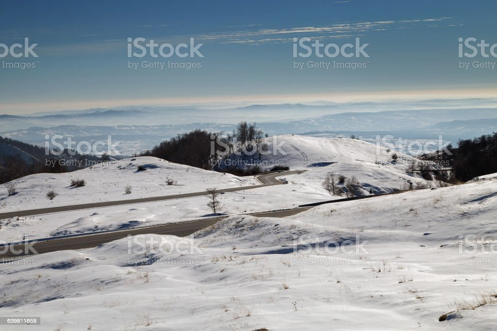 Snow covered mountain road stock photo