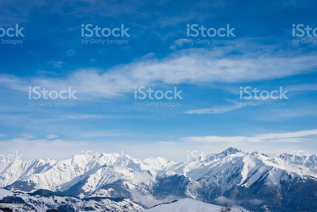 Snow covered mountain tops in the French Alps stock photo