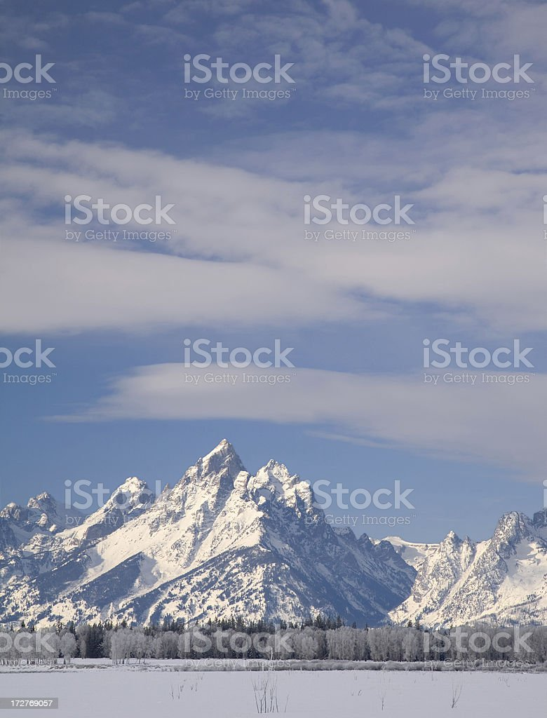 Snow Covered Mountains and Blue Sky in Winter royalty-free stock photo