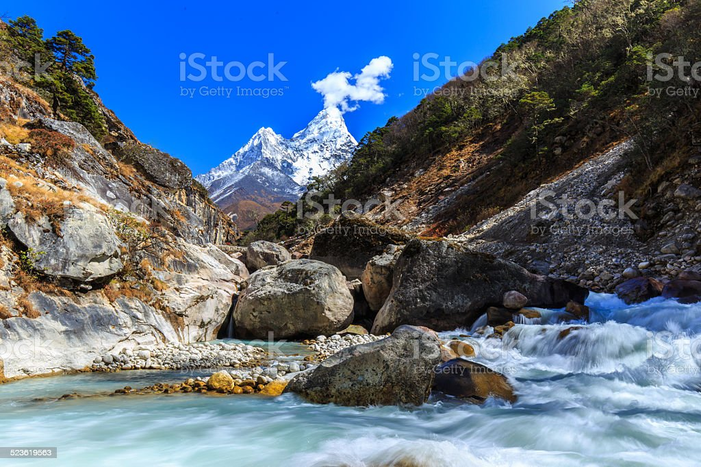 Snow covered mountains and glacier valley stock photo