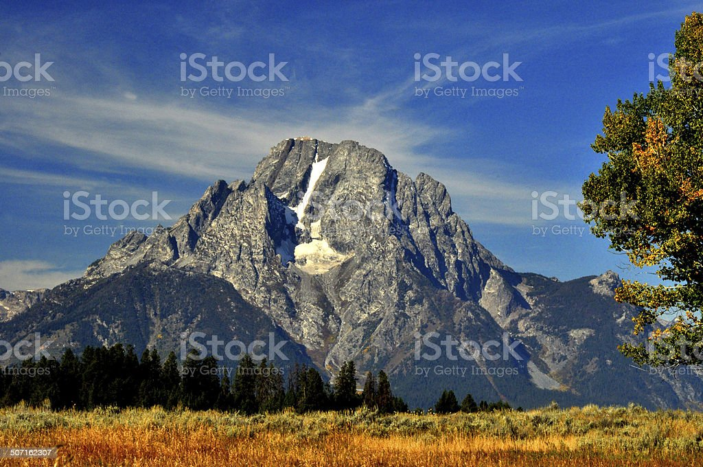 Snow covered mountains and sagebrush. stock photo