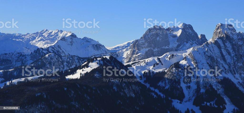 Snow covered mountains Gummfluh and Le Rubli stock photo